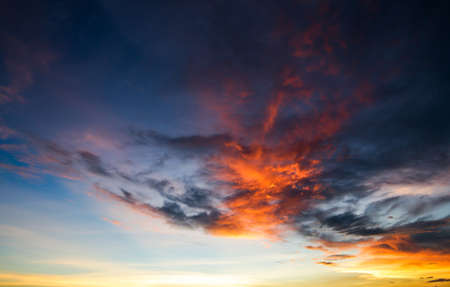 colorful dramatic sky with cloud at sunset..