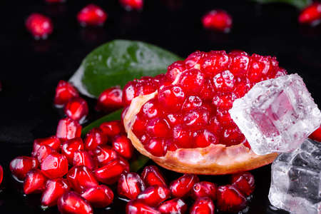 Ripe pomegranate fruits on the wooden background