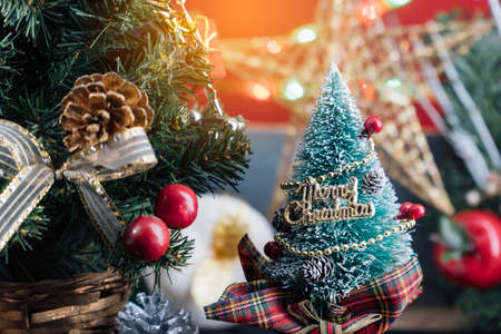 Christmas background with decorations and gift boxes on wooden Stock Photo