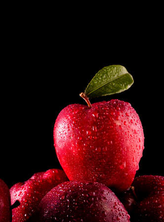 Red apples with leaves on the table