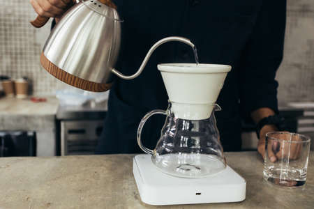 Barista brewing coffee, method pour over, drip coffee
