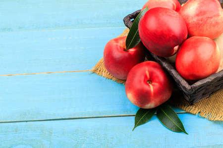 Sweet nectarine on wooden background Zdjęcie Seryjne