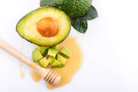 Fresh avocado fruits isolated on white background