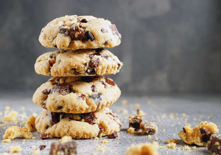 chocolate cookies Fresh organic homemade cookies with chocolate chips and dried berries on parchment paper