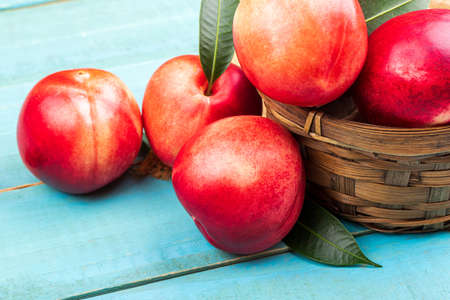 Sweet nectarine on wooden background Foto de archivo