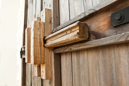 The old wooden latch of ancient doors Stock Photo