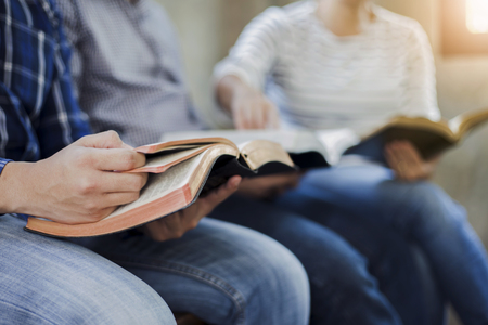close up of christian group are reading and study bible together in Sunday school class room Standard-Bild