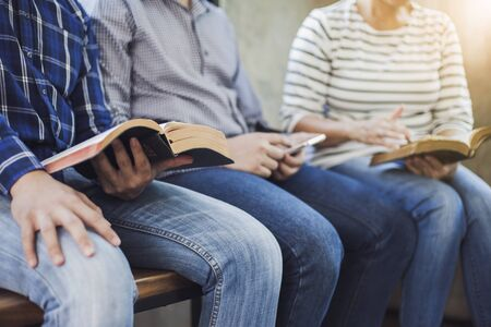 Three christian friends study bible together in church Sunday school class Stock Photo