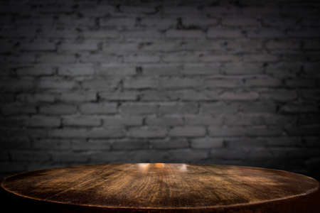 Selected focus empty brown wooden table and wall texture or old black brick wall blur background image. for your photomontage or product display 版權商用圖片 - 79505791