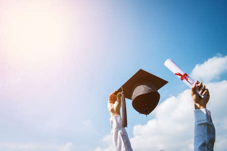 Graduation day, Images of graduates are celebrating graduation put hand up, a certificate and a hat in hand, Happiness feeling, Commencement day, Congratulation