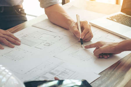 Image of engineer or architectural project, two engineering discussing and working on blueprint with architect equipment, Construction concept.