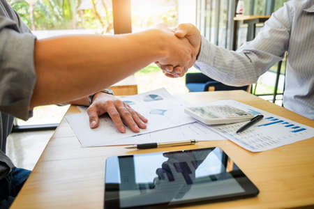 valuation: Images of executive businessman shaking hands after finishing up a meeting, success, happy with work, Connection deal. Stock Photo