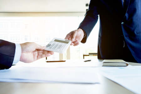 estimating: businessman send calculator to manager for estimation working, invesment concept. Stock Photo