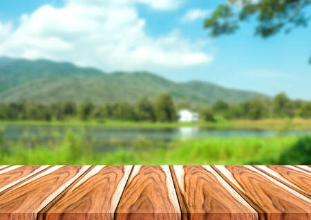 Selected focus empty brown wooden table and outdoors or nature blur background image. for your photomontage or product display. Stock Photo