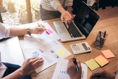 better: Business adviser analyzing financial with new startup finance project plan, co worker team discussing and brainstorming issues to achieve better results, working together, Group of meeting conference. Stock Photo