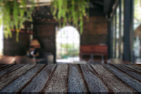 counter top: Empty old black wooden table and blur background of abstract in front of restaurant or coffee shop, cafe  can be used Mock up for display of product or for montage.