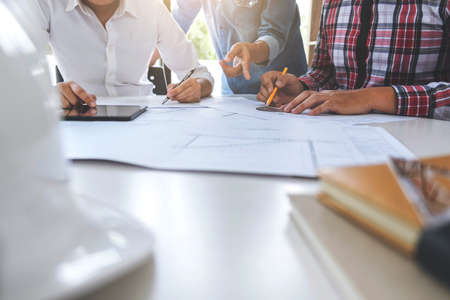 Architect working on blueprint, Engineer meeting working with partner colleagues and engineering tools for architectural project, Construction concept. Stockfoto
