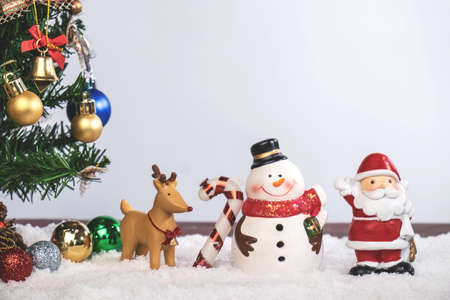 Christmas decoration Holiday or new year with Santa Claus and snowman on snow background and copy space.