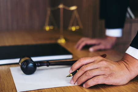 Judge gavel with Justice lawyers, Businessman in suit or lawyer working on a documents. Legal law, advice and justice concept. Standard-Bild