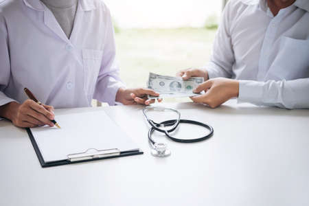 Doctor received corruption money from businessman form of dollar banknotes, Bribery and corruption in Health Care Industry.