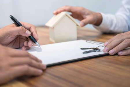 Confident Man Signing Contract Of Loan Agreement Document With