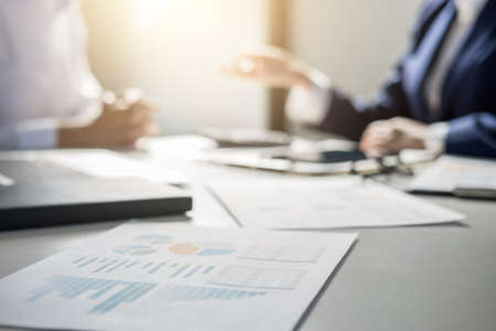 Teamwork of business colleagues consultation market growth on financial document graph report, professional occupation working analyzing startup and investment project to development grow to success.