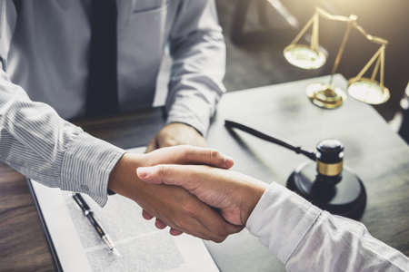 Handshake after good cooperation, Businessman handshake male lawyer after discussing good deal of Trading contract and new projects for the company of real estate, Meeting and greeting concept.