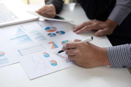 Teamwork process, Business adviser analyzing financial figures denoting the progress in the work of the company. Reklamní fotografie