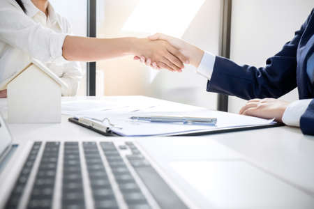 Handshake after good cooperation, Real estate broker residential agent shaking hands with customer after good deal agreement house rent listing contract.