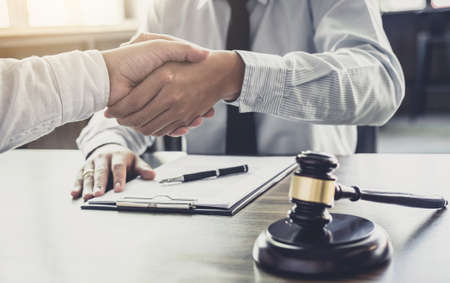 Handshake after good cooperation, Businessman handshake male lawyer after discussing good deal of Trading contract and new projects for the company of real estate Stock Photo