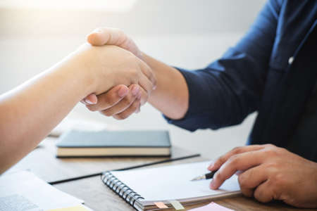 Business partnership meeting concept, Two confident Business handshake and business people after discussing good deal of Trading contract and new projects for both companies, success, partnership.