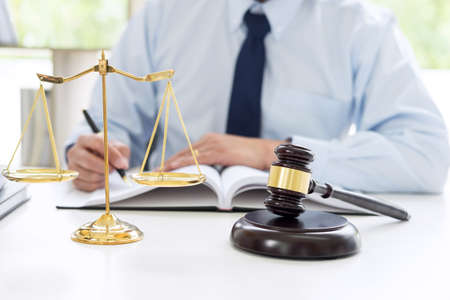 Judge gavel with scales of justice, male lawyers working having at law firm in office. Concepts of law. Stok Fotoğraf