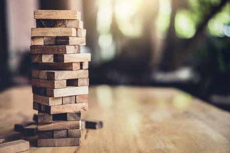 Wood block on the tower, Alternative risk concept, plan and strategy in business, Risk To Make Business Growth Concept With Wooden Blocks. Stock Photo