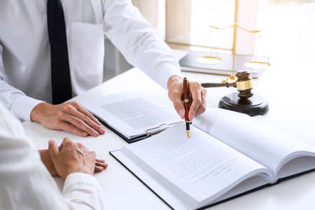 Businesspeople or lawyer having team meeting discussing agreement contract documents Stock Photo