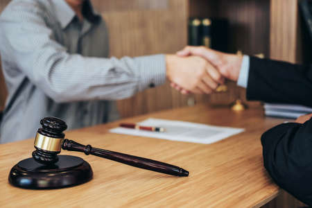 Shaking hands after good cooperation, Businessman handshake male lawyer after discussing good deal of contract, Meeting and collaboration concept. Stock Photo