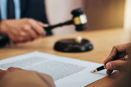 Marriage divorce on Judge gavel deciding, Consultation between a Businesswoman and Male lawyer or judge consult having signing divorce documents, Law and Legal services concept. Stock fotó