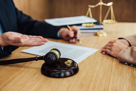 Marriage divorce on Judge gavel deciding, Consultation between a Businesswoman and Male lawyer or judge consult having yes or no to signing divorce documents, Law and Legal services concept.