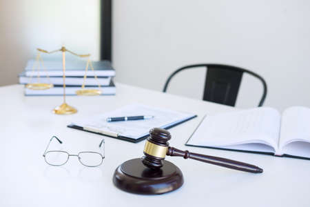 Attorneys suit, Law books, a gavel and scales of justice on a wooden white desktop, Lawyer and justice concept, law, legal advice.