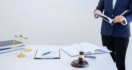 Judge gavel with Justice lawyers, Businesswoman in suit or lawyer working on a documents. Legal law, advice and justice concept. Stock Photo