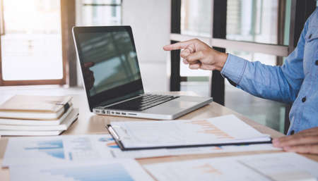 Businessman working analysis finance with calculate about cost on investment, planning data on document, business strategy and accounting concept. Banque d'images