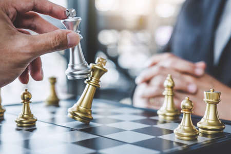 Two businessman playing chess game to plan strategy for success, thinking for planning overcoming difficulty and achieving goals business strategy for win.