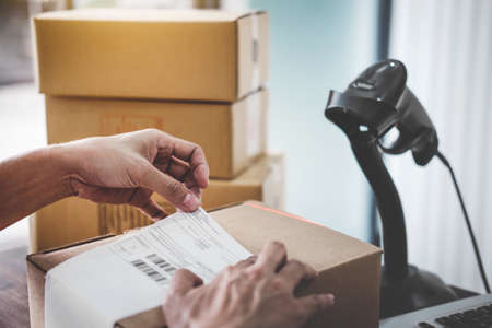Home delivery service and working service mind, Woman working install serial barcode to confirm before sending customer in post office.