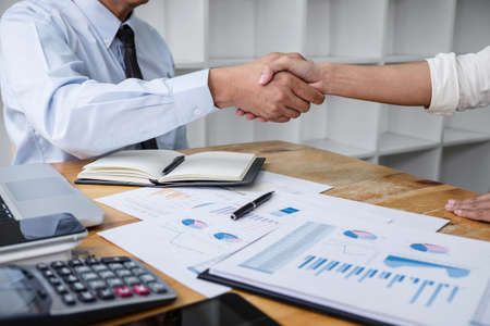 Meeting and greeting concept, Two collaboration business handshake and business people after discussing good deal of contract and new projects for both companies, success of cooperation partnership. Stock Photo