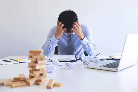 Businessman feeling stress and serious of fail business, Team dispute of failure and exhausted with problems with a pile of work, sadness by bad news. Stockfoto