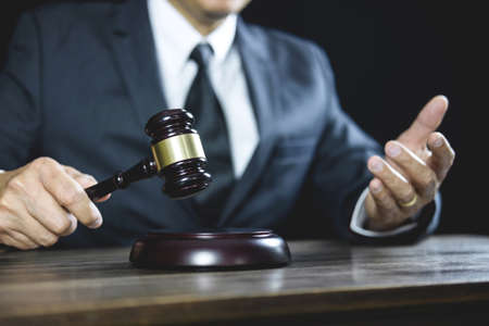 Legal law, Judge gavel with Justice lawyers advice with gavel and Scales of justice, Counselor or Male lawyer working on courtroom sitting at the table and papers.