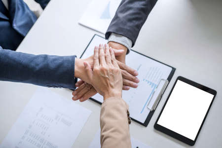 Image of business people joining and putting hands together during their meeting, connection and collaboration concept, Teamwork process of partner and best relationship.