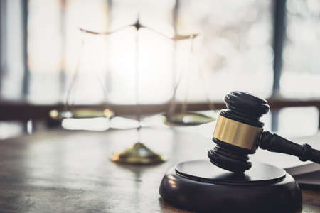 Scales of justice and Gavel on sounding block, object and law book to working with judge agreement in Courtroom, Justice and Law concept. Stockfoto - 125652425