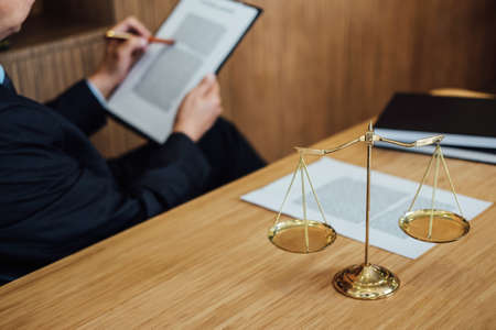 Judge gavel with Justice lawyers, Businessman in suit or lawyer working on a documents. Legal law, advice and justice concept. Stok Fotoğraf