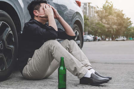 Image of shocked and scared driver after accident involved lying on the road on pedestrian after accident collision with drunk car driver.