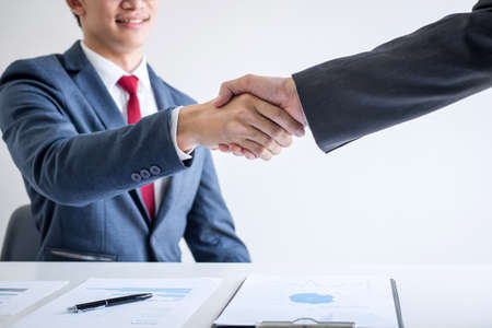 Meeting and greeting concept, Two confident Business handshake and business people after discussing good deal of Trading contract and new projects for both companies, success, partnership, co worker.